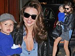 Biker mama! Easy rider Miranda Kerr wears leather jacket on outing with son Flynn