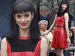 Scarlet woman! The B---- in Apart 23 Krysten Ritter plays up to her devilish reputation in sinful red leather dress