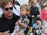 Dad duties! Elton John treats son Zachary to a boat trip as they take in the Sydney Harbour