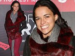 That's a fiery look! Michelle Rodriguez teams fur and leather jacket with burgundy jeans to attend Forever Crazy burlesque show
