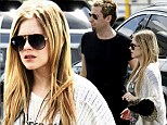 I'm with the band! Avril Lavigne joins Nickelback fiance Chad Kroger on tour around Australia