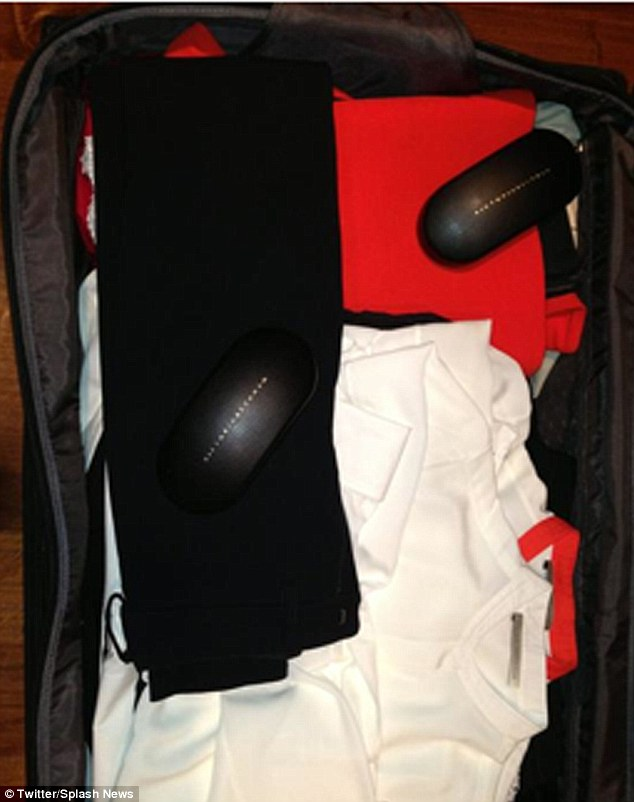 Who knew she was so neat? Victoria Beckham shares a tweet of her suitcase, complete with sunglasses cases and simple white tops