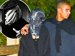 Madonna covered her face like the Elephant Man during a date with boyfriend Brahim Zaibat on Sunday