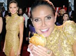 Just don't drop any on your dress! Heidi Klum hits McDonalds for a hearty burger and fries after stunning AMAs appearance