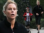 Her own little personal trainer! Julie Bowen struggles to keep up with her five-year-old son as he joins her on a jog on an electric scooter