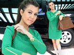 Green fire! Kourtney Kardashian sparkled in an emerald-hued dress to meet sister Khloe for lunch in Miami