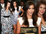 Their latest accessory! Kim and Kourtney Kardashian arrive an hour late to be awarded a key to the city of North Miami