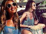She bangs! Candice Swanepoel frolics around the beach in a bikini while trying her hand at the drums