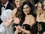 Royal fan: Cheryl somewhat bizarrely compared the Queen's hair to 'candy floss' and praised her 'tiny little dancing shoes'