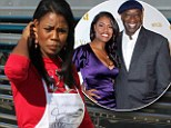 Omarosa Manigault-Stallworth stoically faced cameras on Tuesday as she volunteered in impoverished South Central Los Angeles.