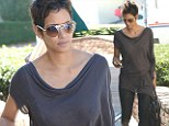 You'd have missed this in France! Halle Berry is curvaceous in sheer top as she enjoys the California sunshine