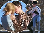Taylor Swift puckers up to John Mayer lookalike...but don't worry it's just for a music video