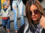 Grunge twinsies! Miranda Kerr and her toddler Flynn wear matching mother-and-son ripped jeans