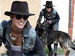 Dog day afternoon: Make-up free Nikki Reed takes her German shepherd Enzo for a walk