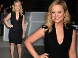 Newly-single Amy Poehler wows in plunging black dress for appearance on Letterman