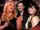 Head over heels: Kelly Clarkson laughed off rumours she's engaged to talent manager Brandon Blackstock while appearing on Ellen on Tuesday
