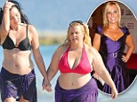 Australia's Biggest Loser host Ajay Rochester passionately kisses another woman as she shows off her much fuller figure in a pink bikini