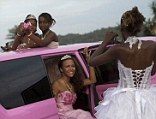 Girls turning 15 pose in their gowns for photos inside a pink limousine before their debutante ball, in the Mangueira favela, or shantytown, in Rio de Janeiro