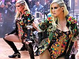 Isn't it a bit early for that? Ke$ha gyrates on stage in high-cut leotard and fishnets on morning TV show