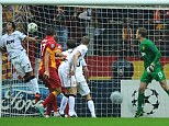 Sneaking in: Yilmaz sees his header go in the goal