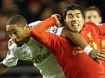 No love lost: Swansea's Ashley Williams (left) and Luis Suarez of Liverpool