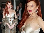 Trashy: Lindsay Lohan slipped into this gold gown for a private dinner to celebrate the Lifetime premiere of Liz & Dick at Beverly Hills Hotel on Tuesday evening