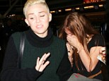 Hair today, gone tomorrow: Miley Cryus crops her locks even shorter... then flees from hysterical fan
