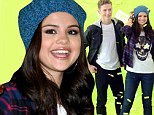 No Bieber! But Selena Gomez makes do with Justin lookalike at photo call for adidas spin-off brand