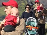Baby's first Thanksgiving! Neve Campbell and boyfriend J.J Field take their three-month-old baby Caspian for a family stroll ahead of the holiday