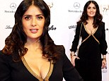 Arresting in ebony! Salma Hayek is a vision in plunging black and gold gown at Germany's Bambi Awards