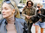 Stone cold fox! Sharon Stone braces against the cold but still manages to flash some serious leg while out with toy boy lover