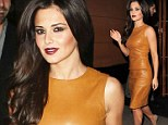 Simply gorgeous: Cheryl looked amazing in her butter leather dress with daring scarlett lipstick