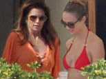 Bikini Thanksgiving! Stacy Keibler and Cindy Crawford enjoy a beachside holiday in Mexico with their hunky other halves