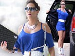 Electric dreams! Jennifer Nicole Lee channels the Eighties in tight, bright blue dress and retro white accessories