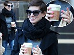 Nailed it! Anne Hathaway brightens up her stylish casual outfit with fun multi-coloured painted talons