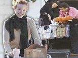 It's turkey time! Marcia Cross and Milla Jovovich load up their trolleys in preparation for the holiday feast