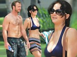 Aloha! Jennifer Lawrence proves she's no shrinking violet as she hits the Hawaiian beach in a pretty purple two-piece