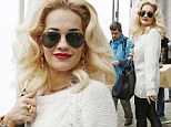 Rita Ora swapped her usually colourful clothes for a monochrome outfit in Germany on Thursday