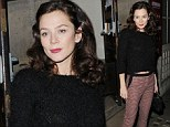 She's never one to dress down: Anna Friel cuts a stylish figure in tight trousers and a cropped jumper as she heads to pub for a post-performance cigarette