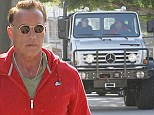 I'll be back... don't give me a ticket! Arnold Schwarzenegger lands his 14 tonne monster truck on the curb in parking fail