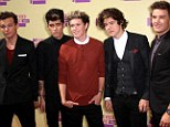 British boyband One Directon make U.S. music history as second album tops the Billboard chart