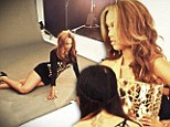 She's back and she's fierce! Tyra Banks stuns in figure-hugging dresses and skin tight corsets in behind-the-scenes shoot