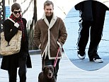 That's unlike you! Anne Hathaway swaps her sophisticated wardrobe for Adidas tracksuit pants during romantic stroll with Adam Shulman