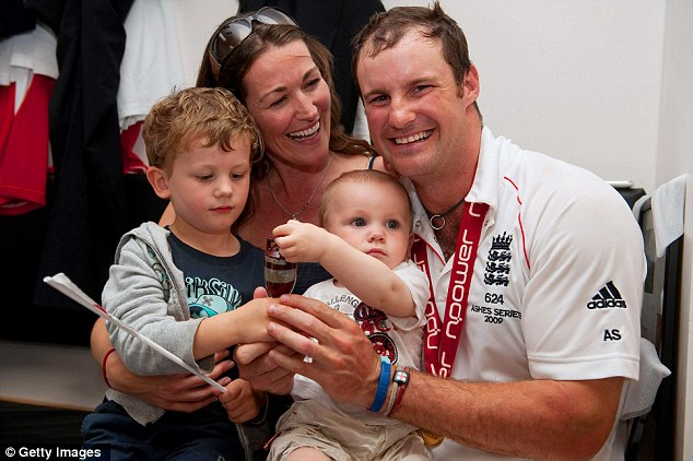 Family man: Strauss celebrates the 2009 Ashes series victory with wife Ruth and sons Samuel (left) and Luca