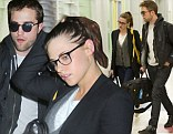 Pictured: Kristen Stewart jets in to JFK with Robert Pattinson, after spending Thanksgiving in London with his family