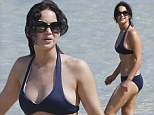 She's a water babe! Jennifer Lawrence cools off in the surf as she enjoys a day at the beach in Maui