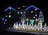 Work of art: Homeowner and designer John Storms said it two him two weekends setting up the display and two to three hours programming the lights to Gangnam Style as well as some other holiday favourites