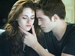 Box office record breaker: Breaking Dawn stars Kristen Stewart, left, and Robert Pattinson have attracted huge audiences