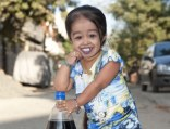 Aspirations: The world's smallest woman Jyoti Amge, 19, is hoping to become a Bollywood star after launching her career on India's version of Big Brother