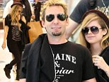 I'm With You: Avril Lavigne is every inch the doting fiancée to Chad Kroger as she accompanies him to Sydney for Nickelback tour